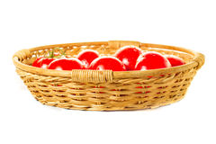 Garden tomatoes basket. On white background Stock Photo