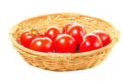 Garden tomatoes basket. On white background Royalty Free Stock Images