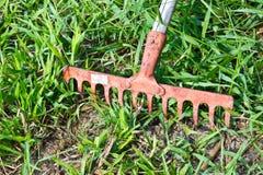 Garden Tool. A garden rake with a wooden handle Royalty Free Stock Image