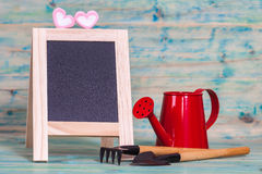 Garden tool and red watering can. Royalty Free Stock Photo
