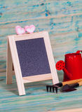 Garden tool and red watering can. Royalty Free Stock Images