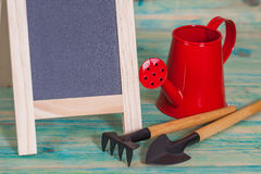 Garden tool and red watering can. Stock Images