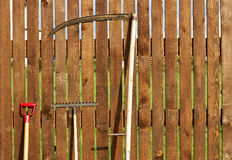 Garden tool set. Over wood backyard fence Royalty Free Stock Photos