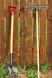 Garden tool set. Over wood backyard fence Royalty Free Stock Photography