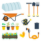 Garden tool set. Vector illustration of gardening and elements: hot house, rake, spade, pitchfork, wheelbarrow, plants in the pots, watering can, bin and lid Stock Photos