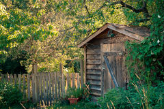 Garden or tool shed. Rustic garden or tool shed in a back yard Stock Image