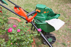 Garden tools. It is spreader and trimer in the yard Stock Photos