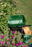 Garden tools. Spreader in the flower field Stock Photo