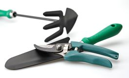 Garden Tools. Gardening tools trowel and cultivator in background white background stock photo