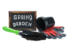 Garden tools and a blackboard with the words in the spring garde Royalty Free Stock Photos