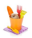 Garden tools in flower pot Stock Photos