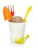 Garden tools in flower pot Stock Image