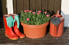 Garden tools:flower pot,watering can,rubber boots Royalty Free Stock Images