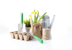 Garden tools, flowers and soil Royalty Free Stock Photos
