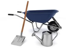 Garden tools. Garden wheelbarrow, watering can and a shovel Stock Photo