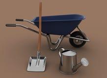 Garden tools. Garden wheelbarrow, watering can and a shovel. Stock Photos