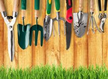 Many gardening tools on wooden background. Garden tools gardening garden tools group isolated equipment stock photos