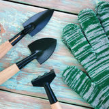 Garden tools - gloves, rakes and blades. Top view Stock Photos