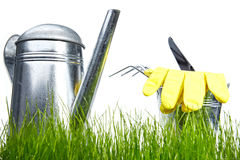 Garden - tools with grass on white Royalty Free Stock Photo