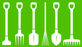Garden tools on green background Royalty Free Stock Photo