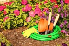 Garden tools on green grass in garden Royalty Free Stock Photos
