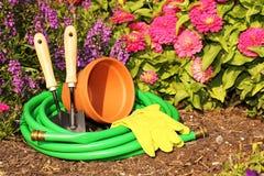 Garden tools on green grass in garden Stock Image