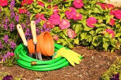 Garden tools on green grass in garden Royalty Free Stock Photo