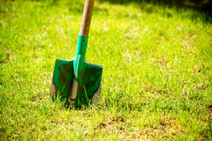 Garden tools on green grass. Royalty Free Stock Photos