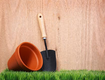 Garden tools on green grass with wood Royalty Free Stock Photo