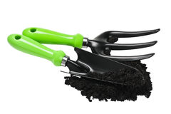 Garden tools in the ground Royalty Free Stock Photo