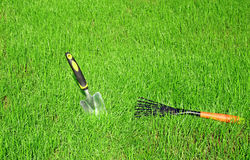 Garden tools for lawn care. Against the background of green grass royalty free stock photography