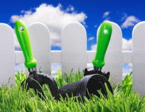 Garden tools on the lawn Royalty Free Stock Image
