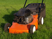 Lawn mower on a grass Royalty Free Stock Photos