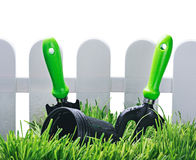 Garden tools near the fence isolated Stock Photos