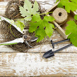 Garden tools  on an old wooden table Royalty Free Stock Images