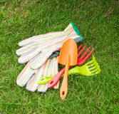Garden tools over green grass Royalty Free Stock Images