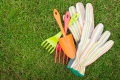 Garden tools over green grass Royalty Free Stock Photos