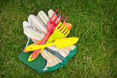 Garden tools over green grass field Royalty Free Stock Photo