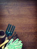 Garden tools over wooden background Royalty Free Stock Photos