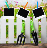 Garden tools and photoframes on a clothespin Royalty Free Stock Photo
