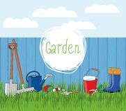 Garden tools and rubber boots on the grass Royalty Free Stock Image