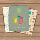 Garden tools set. Decorative hand drawn cards with garden tools on wood plank background. Template for design textile, greeting cards, wrapping paper, packages Royalty Free Stock Photos