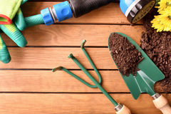 Garden tools set on a wooden table top view Royalty Free Stock Photos