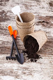 Garden tools (shovel, rake, peat pots ) on old wooden background Stock Photo
