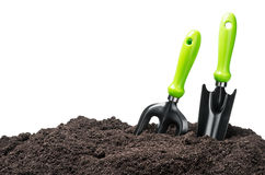 Garden tools in soil isolated on white Royalty Free Stock Image