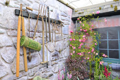 Garden tools on stone wall Stock Photos