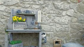 Garden tools on a stone wall backrground stock video
