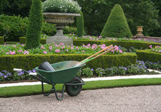 Garden tools waiting to be used. Garden tools in formal garden setting with copy-space Stock Image