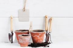 Garden tools on the white shelf Royalty Free Stock Photo