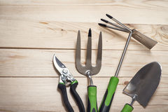 Garden tools on wooden background Royalty Free Stock Photos